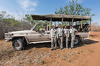 "Africa, Botswana, Kasane, Chobe Game Lodge. Chobe National Park. All women guides, ""Chobe's Angels,"" in the bush with their vehicle. Neo Moatshe, Malebogo Lebo Kgoleng, Oratile Beula, Yazema Connie Bbaena, Saokfufa Sedisa."