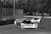 COLUMBUS, OH - OCTOBER 6: The Budweiser/Dyson Racing Porsche 962 101 driven by Price Cobb and Drake Olsen en route to victory in the Columbus Ford Dealers 500 IMSA GTP/Lights race at the temporary Columbus Street Circuit in Columbus, Ohio on October 6, 1985.