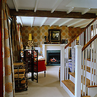 The ground floor of the cottage has been knocked into one to create one large living space with the staircase as a central divide