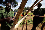 Soilders finish construction on a new hut at the Yao barracks. Most of the Southern Sudan population has family members in the SLPA, and many live in the growing barracks.