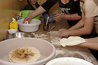 Chechen grandmother with other woman preparing traditional Chechen dish Manty (ravioli with  meat and cheese) for the evening end of the day Ramadan meal, in the kitchen of the URiC Radom Centre..-For security reason, the face of the adult asylum seeker have been evicted of the photography..-For security reason, the names of the adult asylum seeker have been change. .-Article 9 of the Act of 13 June 2003 on grating protection on the Polish territory (Journal of Laws, No 128, it. 1176) personal data of refugees are an object of particular protection..-Cases where publication of a picture or name of asylum seeker had dramatic consequences for this persons and is family back in Chechnya. .Please have safety of those people in mind. Thank you.
