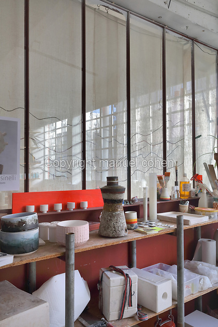 Collection of clay and porcelain bowls, vases and moulds on shelves in the studio of ceramicist Valeria Polsinelli, in Montreuil, a suburb of Paris, France. Polsinelli creates everyday vessels, water jugs, jewellery and figurines and stoppers of female busts, with features and hairstyles from various world cultures. Picture by Manuel Cohen