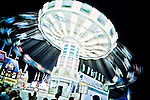 A shutter speed of 1/6 seconds is slow enough to render the whirling children on this carnival ride into colorful blobs at the Montgomery County Agricultural Fair in Gaithersburg, Maryland.