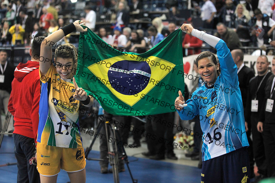 BELGRADE, SERBIA - DECEMBER 22:  Players of Brazil celebrate their victory after the World Women's Handball Championship 2013 Final match between Brazil and Serbia at Kombank Arena Hall on December 22, 2013 in Belgrade, Serbia. (Photo by Srdjan Stevanovic/Getty Images)