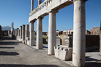 Colonnade around the Forum, Pompeii, 2nd century BC, of two-storey colonnaded porticoes with Doric columns which are lit by the strong light of a summer afternoon