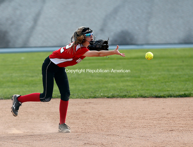 Litchfield, CT- 06 May 2015-050615CM05-  Wamogo's Caitlyn Maliszewski dishes off the ball to first base following a grounder against Northwestern in Litchfield on Wednesday.   Christopher Massa Republican-American