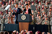 First lady Michelle Obama introduces President Barack Obama to troops and their families at Fort Bragg, North Carolina, Wednesday, December 14, 2011, recognizing their service during Operation Iraqi Freedom and Operation New Dawn, as the war in Iraq comes to an end. Ft. Bragg is a platform of readiness that is postured to rapidly respond globally with full spectrum forces that provide sustained joint operational access capability to combatant commanders while remaining dedicated to providing America's Soldiers, military families, and civilian employees with the quality of life and vibrant community commensurate with their selfless service..Mandatory Credit: Victor Ayala / DoD via CNP