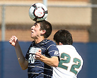 Andy Riemer #20 of Georgetown University heads the ball away from Wesley Curtis #22 of Michigan State during an NCAA match at North Kehoe Field, Georgetown University on September 5 2010 in Washington D.C. Georgetown won 4-0.