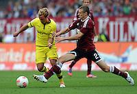 FUSSBALL   1. BUNDESLIGA  SAISON 2012/2013   2. Spieltag 1. FC Nuernberg - Borussia Dortmund       01.09.2012 Mario Goetze (li, Borussia Dortmund)gegen Timmy Simons (1 FC Nuernberg)
