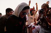 Punjab, Pakistan<br /> November 11, 1988<br /> <br /> Benazir Bhutto arrives at a campaign rally in the Punjab Province.<br /> <br /> Benazir Bhutto is the eldest child of former Pakistan President and Prime Minister Zulfikar Ali Bhutto. She found herself placed under house arrest in the wake of her father's imprisonment and subsequent execution in 1979. In 1984 she became the leader in exile of the Pakistan Peoples Party (PPP), her father's party, though she was unable to make her political presence felt in Pakistan until after the death of General Muhammad Zia-ul-Haq. <br /> <br /> On 16 November 1988 Benazir's PPP won the largest bloc of seats in the National Assembly. Bhutto was sworn in as Prime Minister in December, at age 35 she became the first woman to head the government of a Muslim-majority state in modern times. <br /> <br /> She was removed from office 20 months later under orders of then-president Ghulam Ishaq Khan for alleged corruption. Bhutto was re-elected in 1993 but was again removed by President Farooq Leghari in 1996, on similar charges. Bhutto went into self-imposed exile in Dubai in 1998, until she returned to Pakistan on October 2007, after General Musharraf granted her amnesty and all corruption charges withdrawn.
