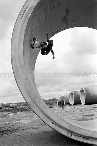 Skateboard star Tony Alva on his board in the California desert, 1978. Photo by John G. Zimmerman.