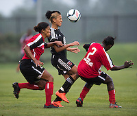Lianne Sanderson (10) of the D.C. United Women fights for the ball with Jessica Kalonji (21) and Odishika Chukwuji (2) of the Virginia Beach Piranhas during the game at the Maryland SoccerPlex in Boyds, Maryland.  The D.C. United Women defeated the Virginia Beach Piranhas, 3-0, to advance to the W-League Eastern Conference Championship.
