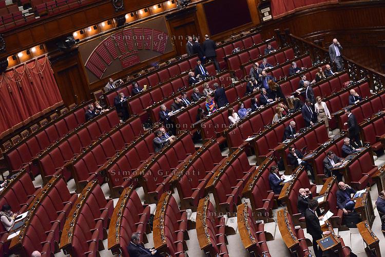Roma, 10 Marzo 2015<br /> La Camera dei Deputati vota si alle Riforme della Costituzione.<br /> Gli scranni vuoti del Movimento5 Stelle che non partecipa al voto e l'intervento di Toninelli.