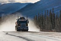 Trucker hauls supplies along the James Dalton Highway, arctic, Alaska.