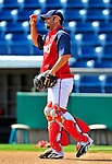 18 March 2009: Washington Nationals' catcher Wil Nieves takes infield drills prior to a Spring Training game against the Florida Marlins at Space Coast Stadium in Viera, Florida. The Marlins defeated the Nationals 7-5 in the Grapefruit League matchup. Mandatory Photo Credit: Ed Wolfstein Photo