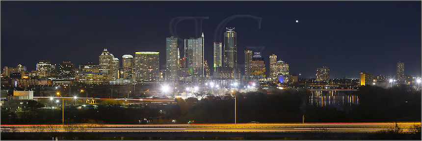 Nighttime from the Zilker Park Clubhouse offers a wonderful view of the Austin Skyline and the highrises that make up this Austin Panorama.  Looking across MoPac, you can see some of the more iconic skyscrapers that make the cityscape, including the Austonian, the 360 Condos, and the Austin Hyatt. To the south (right) of the city is Ladybird Lake and its great hike and bike trails. ..This Austin Pano was taken on a perfect February evening.