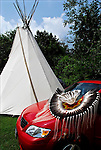 Tepee and Native American regalia on car at theThunderbird Pow-Wow at Queens County Farm Museum a heritage and ethnic pride social gathering celebration