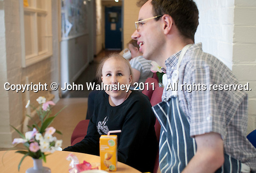 The learning support group take a break in the cafeteria, Adult Learning Centre, Guildford, Surrey.