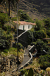 White cottage amongst the mountains, Chejelepes, San Sebastian, La Gomera, Canary Islands, Spain
