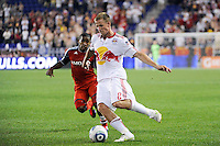 Jan Gunnar Solli (8) of the New York Red Bulls is marked by Joao Plata (7) of Toronto FC. The New York Red Bulls defeated Toronto FC 5-0 during a Major League Soccer (MLS) match at Red Bull Arena in Harrison, NJ, on July 06, 2011.