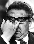 With finger in his eye Henry Alfred Kissinger a German born American political scientist diplomat and recipient of the Nobel Peace prize served as National Security Advisor and Secretary of State for President Richard Nixon and Gerald Ford, Kissinger played a dominant role in United States foreign policy with detente with the Soviet Union  and opening  relations with China and negotiated the Paris Peace Accords ending American involvement in Vietnam War,