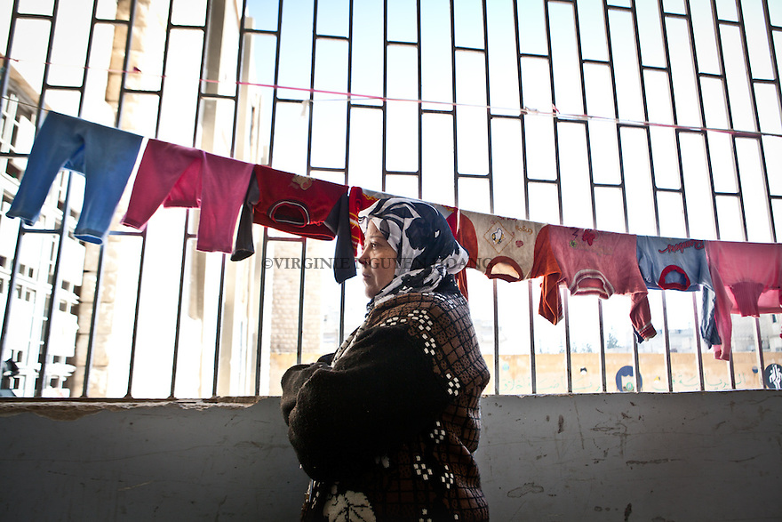 Rabiaa Mohammed is 35 years old and has been living in a school of north-east Aleppo for four months. Her husband and her were living in the west of Aleppo but decided to move as it became too dangerous in their neighboorhoud. Rabiaa just wish that the Revolution takes an end that she can go back home safely..Rabiaa Mohammed a 35 ans et vit dans une école d'Alep depuis 4 mois. Son mari et elle vivaient ands le Nord-est d'Alep mais ils ont décidé de bouger car le qurtier devenait trop dangereux. Rabiaa aimerait juste que la Revolution prenne fin pour pouvoir revenir à la maison tranquillement. .