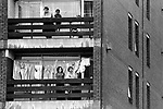 Lewisham, London.1977<br /> National Front supporters cheer and clap from the balcony of their tower block flat.<br /> <br /> Police protect members of the National Front, during the so-called Battle of Lewisham, which took place on 13 August. 500 members of the National Front marched from New Cross to Lewisham, various counter-demonstrations by approximately 4,000 people led to violent clashes between the two groups and between the anti-NF demonstrators and police. 5,000 police officers were present and 56 officers were injured in the riots, 11 of whom were hospitalised. 214 people were arrested for obstructing the police, threatening behaviour, assault, possession of an offensive weapon and throwing missiles. Later disturbances in Lewisham town centre saw the first use of police riot shields on the UK mainland.