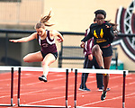 TORRINGTON, CT-051017JS07- Sacred Heart's Nehway Sahn was able to overtake Torrington Riley Silva to win the 300m hurdles during their meet with Wilby Wednesday at Torrington High School. <br /> Jim Shannon Republican-American