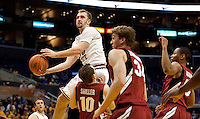 Rihards Kuksiks gets above the crowd of Stanford players to shoot the ball. The Stanford Cardinal, ranked 7th in the Pac-10 defeated the 2nd ranked Arizona State Sun Devils 70-61 during the Pac-10 Tournament at the Staples Center in Los Angeles, California on March 11th, 2010.