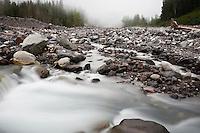 Rocky debris basin of Nisqually river flowing from glacier melt of Mount Rainier, Washington