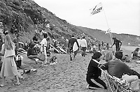 Spectators on the cliffs and on the beach  during the  running of the 1976 Rip Curl Pro, Bells Beach, Torquay, Victoria, Australia. Easter 1976. Founder of Ocean & Earth Brian Cregan (AUS) prepares for his heat..Photo:  joiliphotos.com