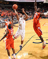 Feb. 2, 2011; Charlottesville, VA, USA; Virginia Cavaliers guard Jontel Evans (1) shoots between Clemson Tigers guard Andre Young (11) and Clemson Tigers forward/center Jerai Grant (45) during the game at the John Paul Jones Arena. Virginia won 49-47. Mandatory Credit: Andrew Shurtleff
