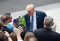United States President Donald J. Trump greets US Treasury employees as he walks to the US Treasury Building with US Secretary of the Treasury Steven Mnuchin to sign Executive Orders concerning financial services in Washington, DC on April 21, 2017.<br /> Credit: Ron Sachs / Pool via CNP /MediaPunch