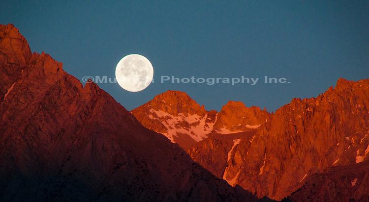 full moon over Sierra Nevada Mountains, Alabama Hills Recreation Area, California