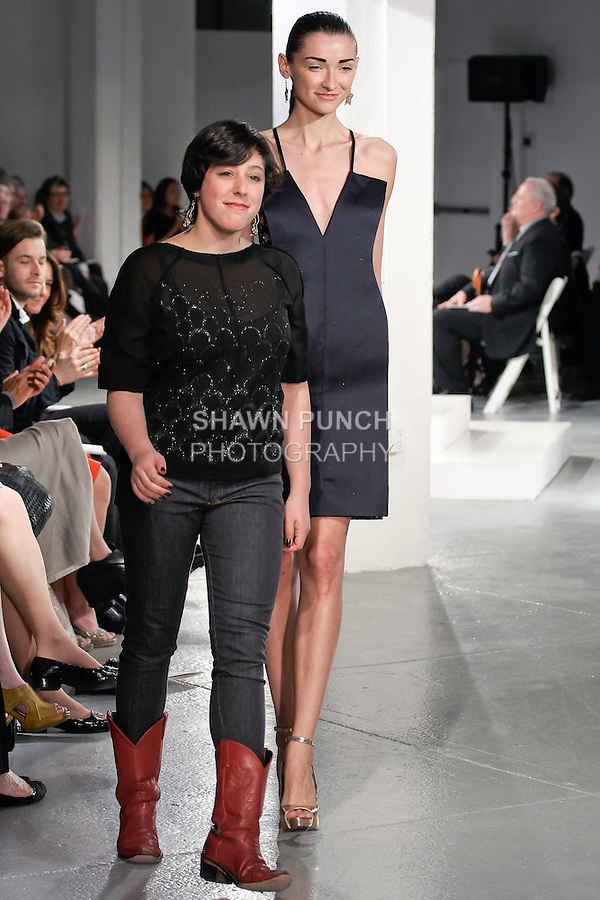 Graduting student designer Ruby Gertz, walks runway with model at the close of the 2012 Pratt Institute fashion show, at Center548 NYC, on April 26, 2012.