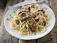 Sauteed wiild organic Pied Bleu Mushrooms (Clitocybe nuda) or Blue Foot mushrooms cooked in butter with spaghetti
