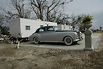 A Rolls Royce is parked in front of a new FEMA trailer in Bay St. Louis after Hurricane Katrina destroyed the home that was once there.