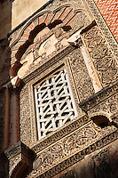 Exterior Window; Doorway of al-Hakan II; Circa 961 AD; Western Facade; Great Mosque, Cordoba, Andalusia, Spain; The motifs are a symmetrical repetition of geometric shapes extended towards infinity by multiplying, dividing and rotating them until they become a metaphor of eternity. Picture by Manuel Cohen