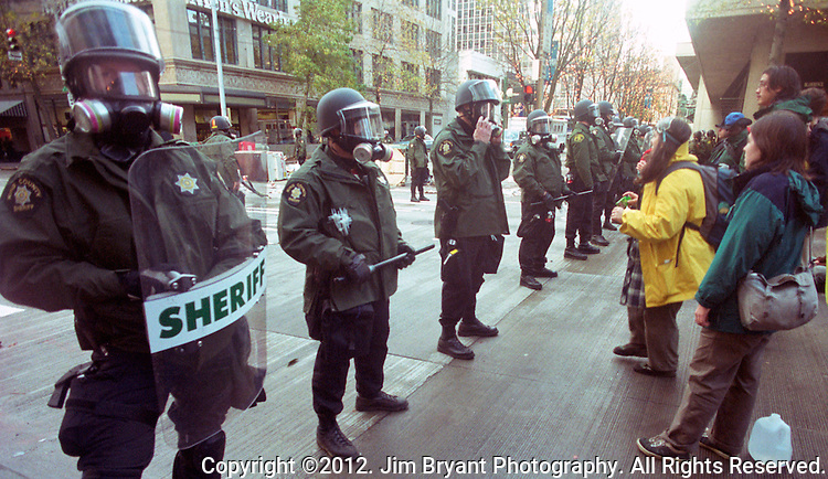 The Battle for Seattle, commonly know at the  WTO in Seattle in 19999  ran from November 30 to December 3, 1999 when members of the World Trade Organization met in Seattle, Washington. The planned negotiations were Interrupted by massive and controversial street protests outside the hotels and the Washington State Convention and Trade Center, in what became the second phase of the anti-globalization movement in the United States. The scale of the demonstrations?even the lowest estimates put the crowd at over 40,000?dwarfed any previous demonstration in the United States against a world meeting of any of the organizations generally associated with economic globalization (such as the WTO, the International Monetary Fund (IMF), or the World Bank. &copy;2012. Jim Bryant Photo. All Rights Reserved