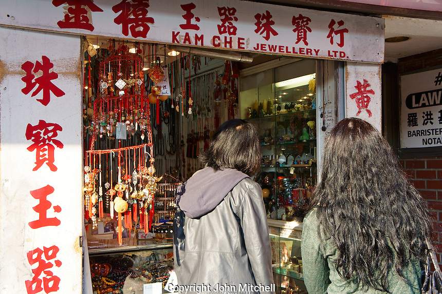 Two women outside a Chinese jewelry store in Chinatown, Vancouver, British Columbia, Canada