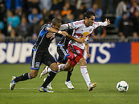 March 10th, 2013: Jason Hernandez fights for the ball alongside with Fabian Espindola during a game at Buck Shaw Stadium, Santa Clara, Ca.   Earthquakes defeated Red Bulls 2-1