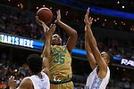11 March 2016: Notre Dame's Bonzie Colson (35) shoots over North Carolina's Brice Johnson (right) and Joel Berry II (left). The University of North Carolina Tar Heels played the University of Notre Dame Fighting Irish at the Verizon Center in Washington, DC in the Atlantic Coast Conference Men's Basketball Tournament semifinal and a 2015-16 NCAA Division I Men's Basketball game. UNC won the game 78-47.