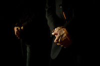 Two patients stand with folded hands during an orthodox church service at a rehabilitation program run by the orthodox church in Sapernoe, Russia, on Saturday, September 15, 2007. About a dozen people at a time live and work at the remote farm, about two hours from St. Petersburg, for a free one year course of treatment.