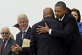 US President Barack Obama (R) hugs civil rights leader and Democratic Representative from Georgia John Lewis (2-R)after Lewis delivered remarks, as former US President Jimmy Carter (L) and former US President Bill Clinton (2-L) look on, during the 'Let Freedom Ring' commemoration event at the Lincoln Memorial in Washington DC, USA, 28 August 2013. The event was held to commemorate the 50th anniversary of the 28 August 1963 March on Washington led by the late Dr. Martin Luther King Jr., where he famously gave his 'I Have a Dream' speech.<br /> Credit: Michael Reynolds / Pool via CNP