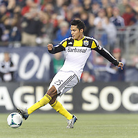 Columbus Crew forward Jairo Arrieta (25) passes the ball.  In a Major League Soccer (MLS) match, the New England Revolution (blue) defeated Columbus Crew (white), 3-2, at Gillette Stadium on October 19, 2013.