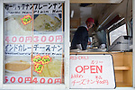 A mobile store selling Nepali fare outside a ski run in Hirafu in the Niseko ski region of Hokkaido, Japan on Feb. 9 2010. Niseko is renowned for its powder snow and wide range of apres ski attractions, including fine cuisine.