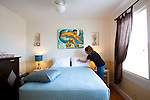 Paia Inn on the North Shore of Maui.  This hotel is located in a  quiet beachfront community and has a private entrance to Paia Bay. A Delux Room.