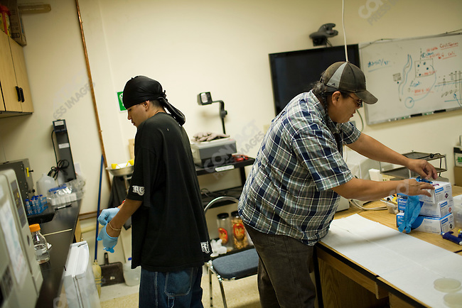 Isaiah Stotler works with Fred Blackwolf Jr. on the campus of Chief Dull Knife College in the town of Lame Deer, Montana which is on the Northern Cheyenne Indian Reservation.