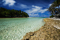 A chanel runs between ocean and lagoon at Eneko Island, Majuro Atoll, Marshall Islands