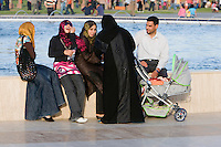 Tripoli, Libya, North Africa - Libyan Family at the Park.  Modern Libyan Women's Clothing Styles as seen in Public Park near the Green Square, downtown Tripoli.